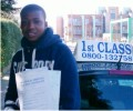 Olamide with Driving test pass certificate