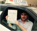 Chris with Driving test pass certificate