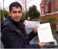 Ali with Driving test pass certificate