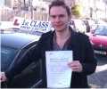Dejan with Driving test pass certificate