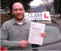 Duncan with Driving test pass certificate