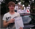 Edvinas with Driving test pass certificate