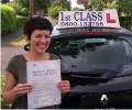 Emily with Driving test pass certificate
