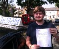 Kasey with Driving test pass certificate