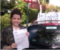 Lucy with Driving test pass certificate