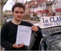 Peter with Driving test pass certificate