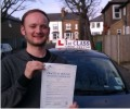 Richard with Driving test pass certificate