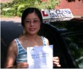 Wang with Driving test pass certificate