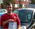 Jake with Driving test pass certificate
