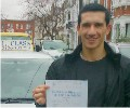 Julian with Driving test pass certificate
