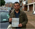 Khalid with Driving test pass certificate