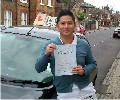 Yi with Driving test pass certificate