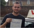 Jacek with Driving test pass certificate