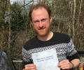 Jason with Driving test pass certificate