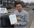 Justin with Driving test pass certificate
