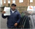 Shane with Driving test pass certificate