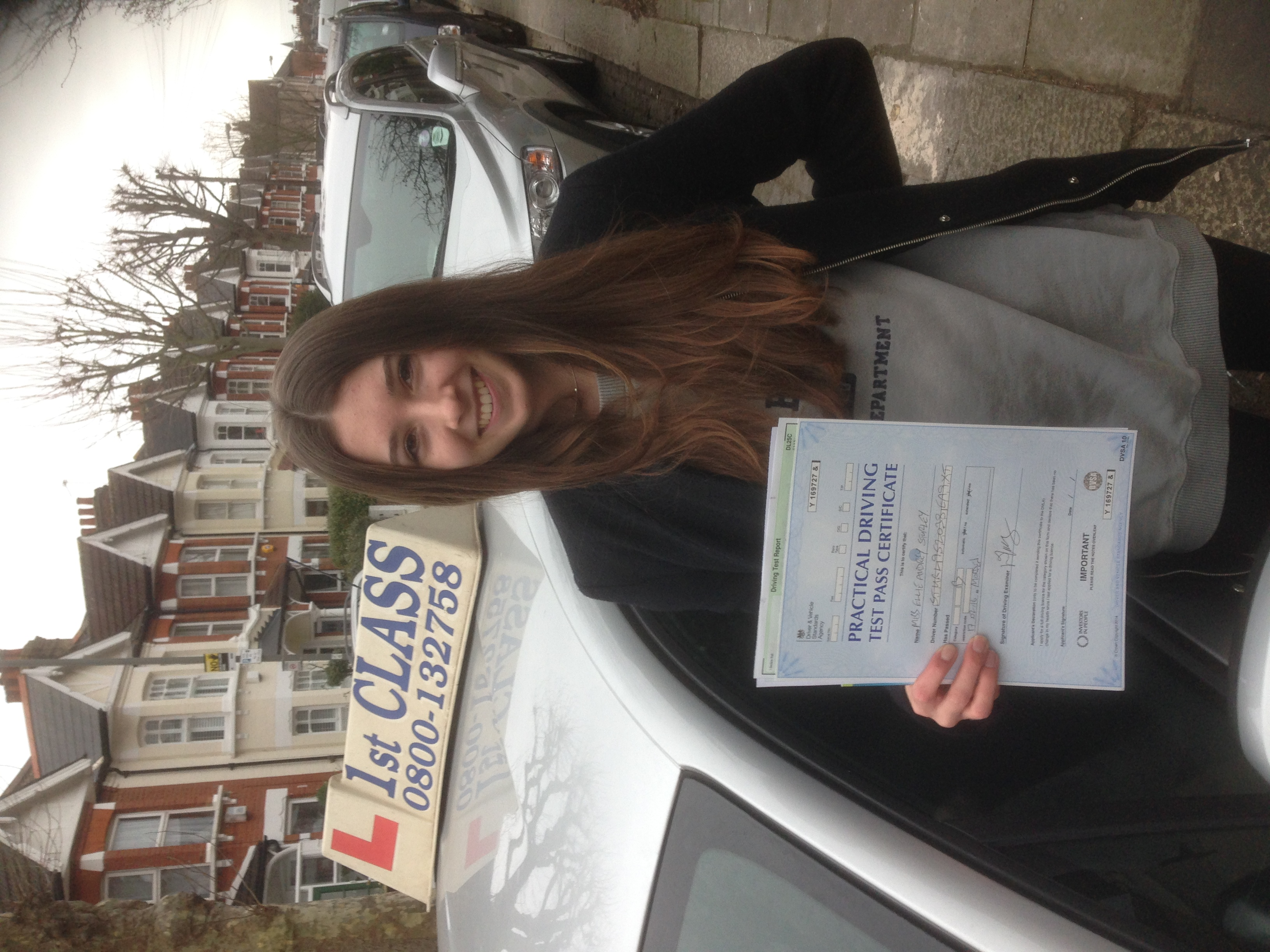 Ellie with Driving test pass certificate