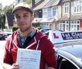 Charlie with Driving test pass certificate