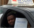 Damalo with Driving test pass certificate