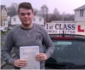 Harry with Driving test pass certificate