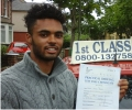 Lewis with Driving test pass certificate
