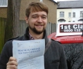 Lukasz with Driving test pass certificate