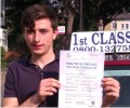 Luke with Driving test pass certificate