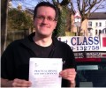 Matthew with Driving test pass certificate