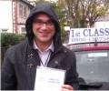 Oleg with Driving test pass certificate