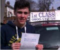 Robbie with Driving test pass certificate