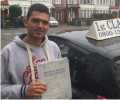 Akiva with Driving test pass certificate