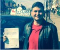 Andre with Driving test pass certificate