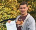 Ben with Driving test pass certificate