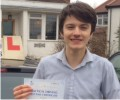 Daniel with Driving test pass certificate