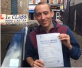 Dean with Driving test pass certificate