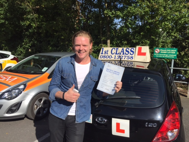 Jay with Driving test pass certificate